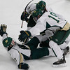 Record-Eagle/Jan-Michael Stump<br /> Traverse City West players Collin Peters (7) and Caleb Breithaupt (19) celebrate Jake Saxton's (3) overtime goal in Wednesday's 3-2 win over the Bay Reps at Howe Arena.
