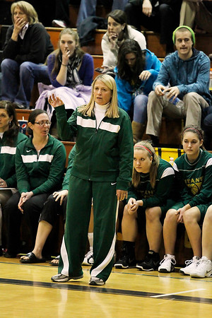 Record-Eagle/Jan-Michael Stump<br /> Traverse City West coach Patti Tibaldi directs earned her 700th career victory Saturday. The Titans beat Mt. Pleasant, 46-36.
