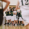 Record-Eagle/Keith King<br /> Traverse City West varsity girls basketball players cheer for their teammates after a basket is scored against Ogemaw Heights on Friday at Traverse City West High School.