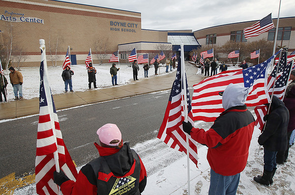 Record-Eagle/Keith King<br /> Flags are held outside of Boyne City High School Saturday, December 10, 2011 prior to the 'celebration of life' ceremony for fallen Boyne City Army Pvt. Jackie Lee Diener II.