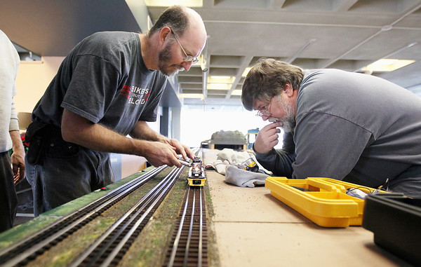 Record-Eagle/Keith King<br /> Jerry Pasman, left, of Interlochen, and John Mallard, of Grawn, make adjustments to the sound system on a model locomotive as preparations are made by members of the Northern Michigan Railroad Club at the History Center of Traverse City for the Festival of Trains, which begins Wednesday, Dec. 14.