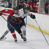 Record-Eagle/Jan-Michael Stump<br /> Bay Reps forward Nick Sicinski (8) tries to stop Traverse City West forward Tyler Thirlby (14) in the third period of Wednesday's game.