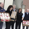 Record-Eagle/Lisa Perkins<br /> Tom's Food Markets and Miller Poultry representatives, (left to right) Len Neeb, Jane Deering, Jim Cataline, Christine Kuhnke and Doug Kehl, unloaded some of the 4,000 pounds of frozen chicken drumsticks the store will donate to area food pantries.