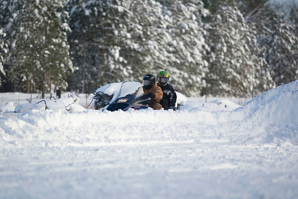 Record-Eagle/Jan-Michael Stump<br /> Randy Erdley, front, and Jacob Gittens ride their snowmobile on the Boardman Valley Trail trail near Rasho Road in East Bay Township on Saturday morning.