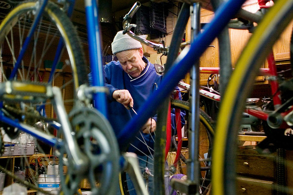 Record-Eagle/Jan-Michael Stump<br /> Don Cunkle has been repairing old bikes in his garage for homeless shelters and non-profit aid agencies around Traverse City for three years. He said he's repaired about 120 this year -- up from 100 last year -- and will keep working until it gets too cold in his unheated garage.