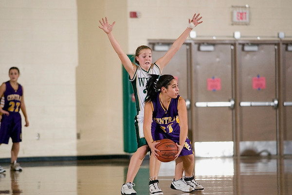 Record-Eagle/Jan-Michael Stump<br /> Traverse City West's Jessica Harding (21) defends Bay City Central's Torie Salinas-Martinez (32) in the second half of Tuesday's game.