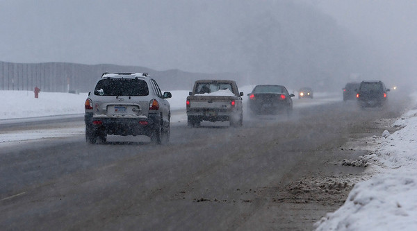 Record-Eagle/Douglas Tesner<br /> Cars move down South Airport Road. Plow crews may be required to keep just one wheel track cleared during storms.
