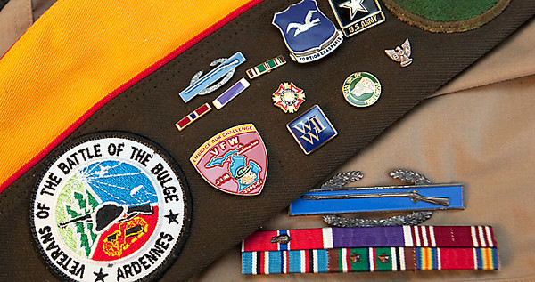Record-Eagle/Douglas Tesner<br /> Keepsakes belonging to Jim Wibby, a local Battle of the Bulge veteran.