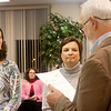 Record-Eagle/Douglas Tesner<br /> Kelly Hall, left, and Julie Puckett take the oath of office as incoming Traverse City Area Public Schools school board members from board president Fred Tank. They will take office in January.
