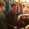 Record-Eagle/Douglas Tesner<br /> Alex Fancy and Max Walker, both of Traverse City, receive some assistance from Lizzie Andriese at Ella's Vintage and Retro Apparel during Men's Night in downtown Traverse City, sponsored by the Downtown Traverse City Association.