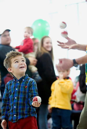 Record-Eagle/Jan-Michael Stump<br /> Raef Bebeau, 5, juggles with Tommy Tropic during Fox Grand Traverse's Toys for Tots party Saturday to celebrate the drive's success. The dealership has collected nearly 200 boxes of toys with a week left in the drive for Toys for Tots, which will distribute them to children in need during the holidays.