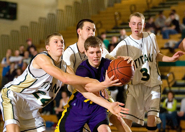 Record-Eagle/Jan-Michael Stump<br /> Traverse City West's Evan Schultz (24), Trevor Tooley (22) and Graeme Placek (30) try to trap Bay City Central's Andrew Butts (12) at the end of Tuesday's game.