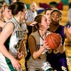 Record-Eagle/Jan-Michael Stump<br /> Traverse City West's Gabby Muller (11) looks for her shot over Bay City Central's Whitley Henry (33).