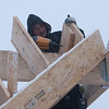 Record-Eagle/Douglas Tesner<br /> Despite the snow, Dustin Collier, of Collier Construction, uses a nail gun to drive nails in a two-story garage he is building in Traverse City.