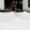 "Record-Eagle/Jan-Michael Stump<br /> Matt Shell shovels snow on North Spider Lake Road on Thursday afternoon. ""Not enough snow for Christmas yet, it doesn't quite feel like it,"" Shell said of the inch he cleared from his friend's driveway."