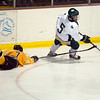 Record-Eagle/Jan-Michael Stump<br /> Traverse City West forward Mitchell Snider (5) skates past an outstretched Traverse City Central forward Cooper Macdonell (7) in the second period of Tuesday's game.