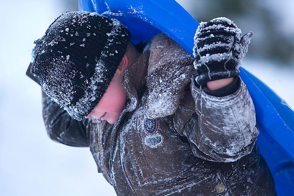 Record-Eagle/Jan-Michael Stump<br /> Devin Royston, 5, of Buckley climbs back up the hill near the Rogers Observatory on Birmley Road while sledding with his family on Tuesday afternoon.