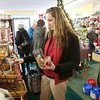 Record-Eagle/Douglas Tesner<br /> Sarah Bechtold does some last-minute holiday shopping for her black lab, Harley, at the D.O.G. Bakery Thursday in downtown Traverse City. According to owner Karry Barolo, business was brisk.