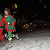 Record-Eagle/Garret Leiva<br /> Scott and Jan Baty, of Traverse City, get into the spirit of the season as they run down Front Street during the third annual Jingle Bell 5K run/walk in downtown Traverse City. Sponsored by the Traverse City Track Club, the non-competitive run featured runners wearing bells on their shoes instead of timing chips. Participants were also encouraged to bring a non-perishable food item to benefit the Trinity Lutheran food pantry.