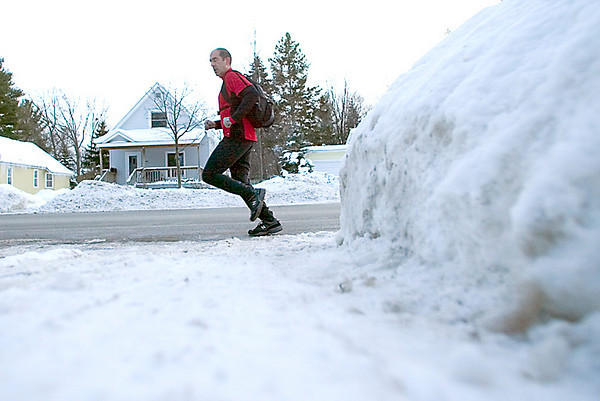 """Record-Eagle/Jan-Michael Stump<br /> Phil Perkins runs home from work at Munson Hospital on Wednesday afternoon. """"I ride my bike unless the conditions are bad, then I run,"""" he said."""