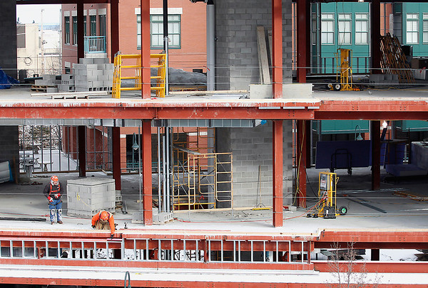 Record-Eagle/Jan-Michael Stump<br /> Work progresses on Hagerty Insurance's $7.1 million building on Lake Street, which should be completed by summer. Spence Brothers Construction recently finished erecting the steel structure of the more than 58,000-square-foot building, so can now begin on the exterior and interior.