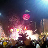 Record-Eagle/Jan-Michael Stump<br /> <br /> People celebrate as the Cherry Ball drops at the intersection of Front and Cass Streets in Traverse City, and 2011 begins.