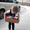 Record-Eagle/Jan-Michael Stump<br /> Ada Maas, 7, smiles at her brother Garrett Maas, 11 (not pictured) as they carry boxes of cake mix, frosting, candles and decorations for the Goodwill Inn.