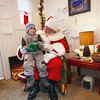 Record-Eagle/Keith King<br /> Santa Claus sits with Will Sutton, 3, of Traverse City, in downtown Traverse City.