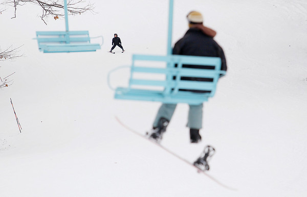 """Record-Eagle/Keith King<br /> A skier travels down a run at Mt. Holiday in Traverse City. """"The weather is the limiting factor right now,"""" Mike Wolf, ski school director, said about why many runs are unable to be open. """"If Mother Nature cooperates, we can get those (snow) guns going full blast."""""""
