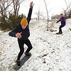 """Record-Eagle/Keith King<br /> Tyler Franz, left, and Jake Keenan, both of Traverse City, ride snowskates Wednesday, December 28, 2011 at Hannah Park in Traverse City. """"We skateboard all the time so when the snow comes we might as well do something that's close to skateboarding,"""" Franz said of snowskating. """"There's enough snow to do it at least,"""" Franz said."""