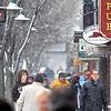 Record-Eagle/Keith King<br /> Pedestrians walk as snow falls Thursday, December 29, 2011 in downtown Traverse City.