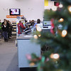 Record-Eagle/Keith King<br /> Last-minute holiday shoppers wait in line Saturday at Best Buy in Traverse City.