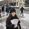 Record-Eagle/Keith King<br /> Colleen Paveglio, marketing director with the Traverse City Downtown Development Authority, holds downtown Traverse City gift certificates Thursday, December 29, 2011 at the intersection of East Cass Street and Front Street.