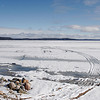 Record-Eagle file photo/Douglas Tesner<br /> This February file photo shows snowmobile tracks left by two Benzie County men who died after their snowmobile crashed through the ice on Crystal Lake.