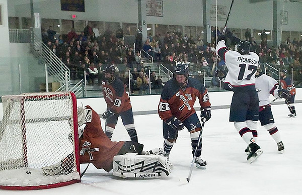 Record-Eagle/Douglas Tesner<br /> Traverse City forward Garrett Thompson (17) celebrates one of his two goals against Marquette goalie Kevin Kissaw, left, as Rangers defenders Tanner Kero (10) and Nate Taurence (3) look on.
