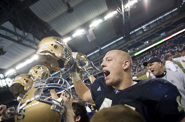 Record-Eagle file photo/Jan-Michael Stump<br /> Traverse City St. Francis' Max Bullough and teammate celebrate their 42-8 win over Hudson in the Division 7 state final in Detroit.