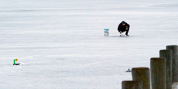 "Record-Eagle/Douglas Tesner<br /> Clayton Hall, of Williamsburg, tries his luck at ice fishing on Boardman Lake in Hull Park near the boat ramp. ""I was out here on Christmas Day and caught two nice northern pike,"" said Hall. According to Hall, the ice was about 4 inches thick around the location he was fishing. Colder temperatures and snow are expected to continue through the week."