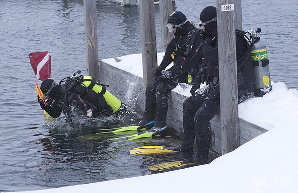 Record-Eagle/Douglas Tesner<br /> Divers from Scuba North swim in cold Grand Traverse Bay at the Clinch Park Marina. Scuba North has been holding the New Year's Day dive for more than 25 years.
