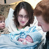 Record-Eagle/Douglas Tesner<br /> Erin Johns holds her new son, Mason, as her daughter Annika, 2, and husband Benjamin look on.  Mason was the first baby of the new year to be born at Munson Medical Center at 7:53 a.m.