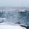 Record-Eagle/Douglas Tesner<br /> Brutal winds, cold water and lake effect snow slam the breakwater at Clinch Park Marina on New Year's Day.
