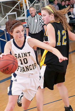 Record-Eagle/Douglas Tesner<br /> St. Francis' Cassie Williams (10) drives against Glen Lake's Sophie Ewing (12).