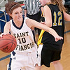Record-Eagle/Douglas Tesner<br /> St. Francis' Cassie Williams (10) drives against Glen Lake's Sophie Ewing (12).