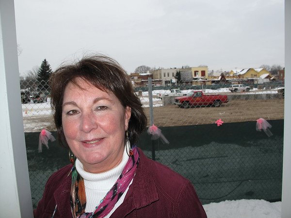 Record-Eagle/Sheri McWhirter<br /> Donna McDonald owns Bay Bridal Boutique on East Eighth Street, next door to the Old Town parking deck construction site. The work has complicated customer parking in the area and slowed revenues at some businesses, including hers, McDonald said.