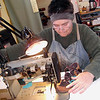 Record-Eagle/Lisa Perkins<br /> Sue Swain, owner of Toe Togs, stitches a pair of custom-made shoes in her Eastport workshop.