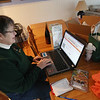 Record-Eagle/Keith King<br /> Lynn Ebinger, of Traverse City, shops local retailers online Nov. 26 from her home.