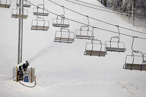 Record-Eagle/Jan-Michael Stump<br /> A new quad-lift runs between Thor and Loki on Crystal Mountain, where snowguns work to  cover the slopes Wednesday.
