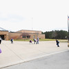 Record-Eagle/Keith King<br /> Students return to Blair Elementary School during the early afternoon Monday in Blair Township. School officials didn't hold morning classes at Blair after a report of a man with a gun in the vicinity.