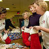 Record-Eagle/Douglas Tesner<br /> Beverly Jody, Tracy Reightley, and Michelle Thomas take part in a Christmas stocking party SAturday at VFW Post 2789 in Traverse City. The husbands of all three women serve with the U.S. Army 1434th Engineer Company, currently in Iraq. Along with members of the post, the Ladies Auxiliary and the Mens Auxiliary, the three stuffed stockings with candy and other items including cards and letters written by area schools.