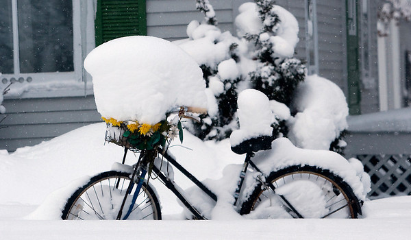 Record-Eagle/Douglas Tesner<br /> More than a foot of snow is piled on a bicycle left outside a home on Ninth Street in Traverse City Friday.
