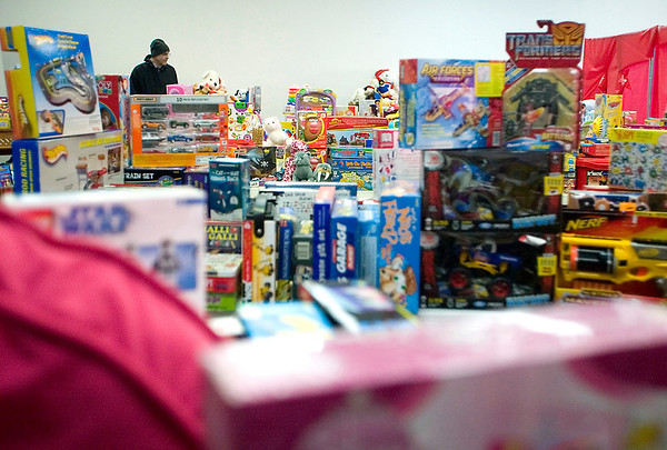Record-Eagle/Jan-Michael Stump<br /> Fr. Fred Foundation Director of Development Dave Abeel takes pictures of toys donated to Toys for Tots for the foundation's scrapbook the day before they are to be distributed to families. The foundation will distribute over 2900 toys to over 250 families who registered. The foundation's Traverse City distribution point on Garfield Road is one of 17 sites in the area giving new, unopened donated gifts to registered families.